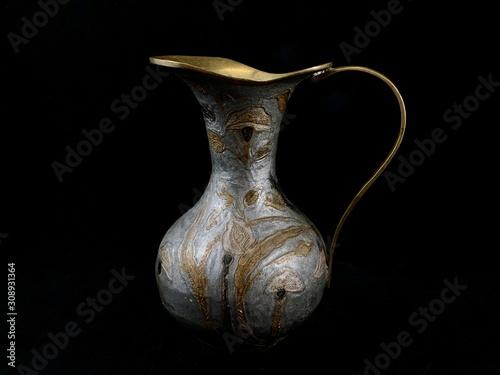 Copper antique vase on a black background Canvas Print