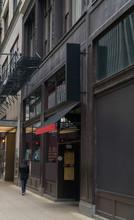 Generic Restaurant Bar Exterior Establishing Shot Facade On City Street Sidewalk. Nightlife Attraction Destination In The Day Time