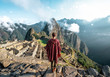 Man observing the ruins of Machu Picchu