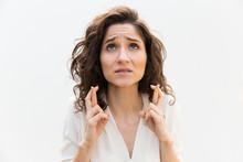 Anxious Woman Keeping Fingers ...