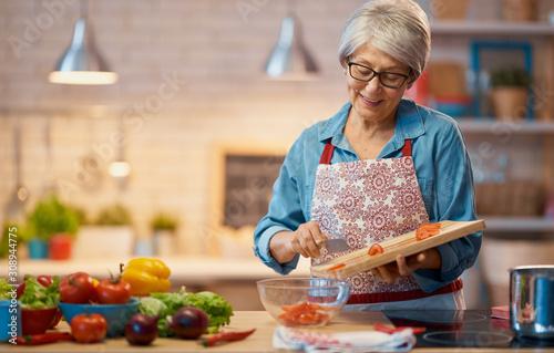 Fototapeta woman is preparing the vegetables obraz
