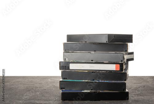 Fényképezés  VHS videotape on a black table with isolated background