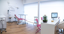 Dental Office Interior With Dentist Chair And Medical Equipment
