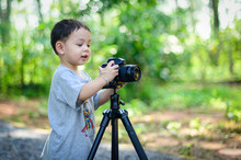 Boy Is Photographer Holds A C...