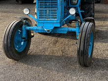 Blue Tractor In Autumn Rainy P...