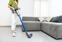 Woman Cleaning Floor With Cord...