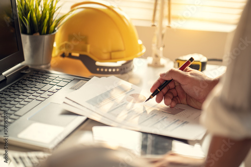 Hand of Business people working document about budget profits and planning of construciton project