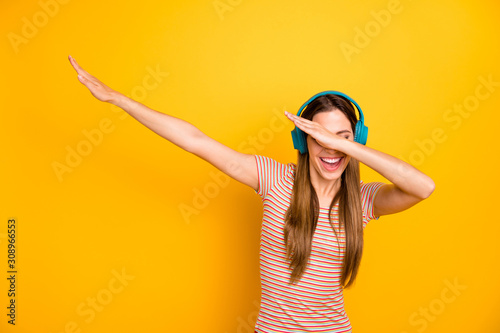 Photo of beautiful lady good mood listen music in cool wireless earphones dancin Fototapet