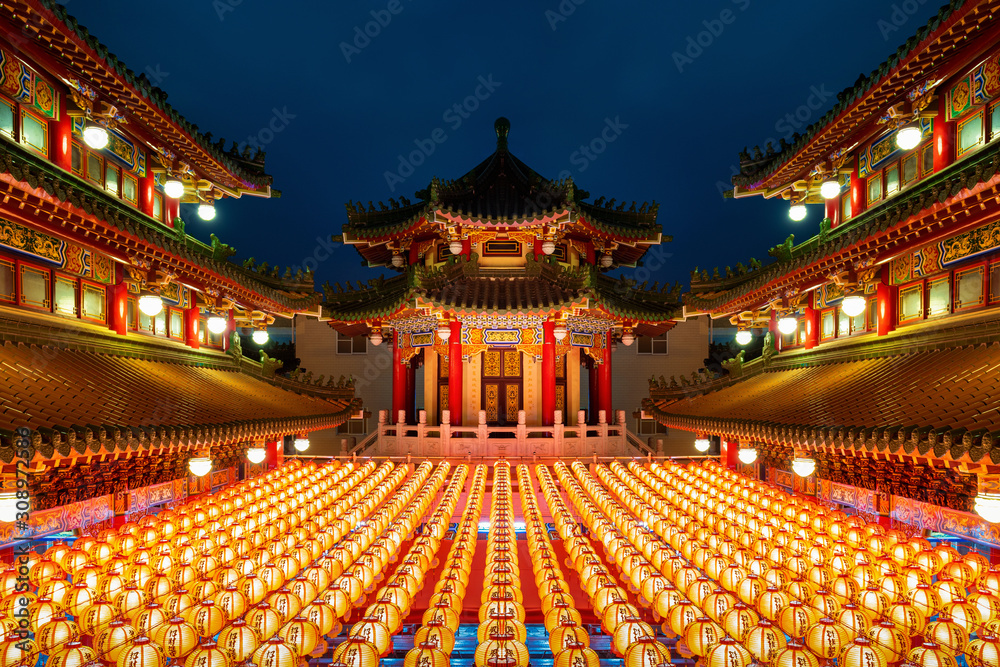 Fototapeta Chinese new year, Traditional Chinese lanterns display in Temple illuminated for Chinese new year festival.
