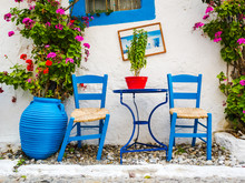 Greece: Typical Greek Blue Chairs And Table In A Small Cafeteria