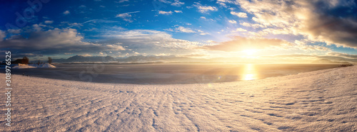 Fototapety, obrazy: Winter sunset landscape with lake, snowy bank, mountains on background, blue sky with clouds and sun. Liptovska Mara, largest water reservoir (dam) in Slovakia (Slovensko), large panorama