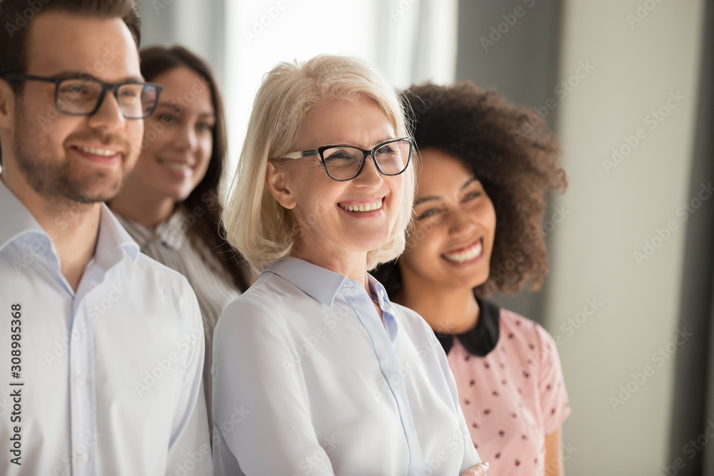 Diverse smiling team posing for group picture together