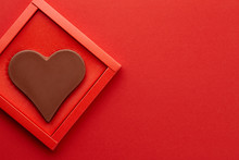 Valentines Day Chocolate Heart On Red Background
