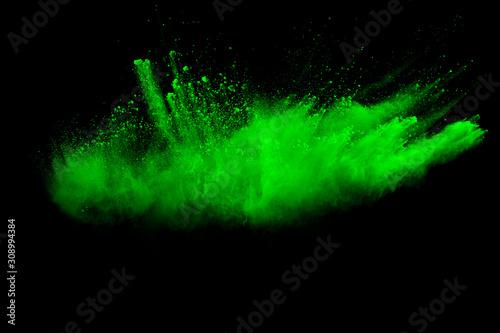 Cuadros en Lienzo  Green color powder explosion cloud on black background
