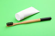 canvas print picture - Natural bamboo toothbrush and paste on green background