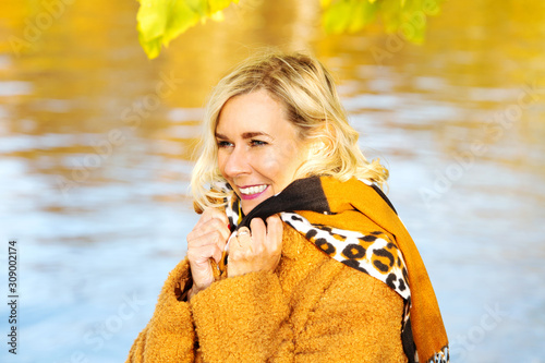 blond woman in her 40s outdoors enjoying the autumn sun Tablou Canvas