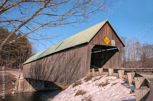 The Lincoln Covered Bridge, known for its unusual green roof, located in Woodstock, Vermont in Winter Wallpaper Mural