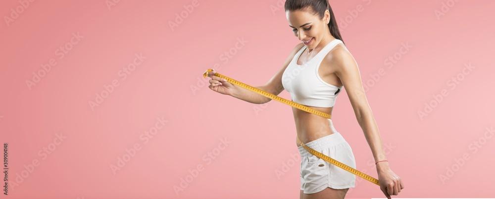 Obraz Fitness woman weight loss, slim body, healthy lifestyle concept fototapeta, plakat