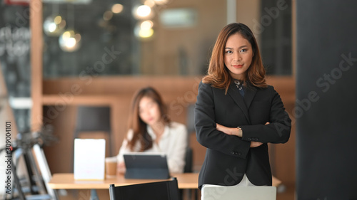 Confidently  asian businesswoman standing on front of office workplace Canvas Print