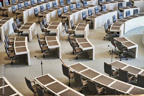 Fototapeta Empty row of chairs with work tables in the plenum of the Lower Saxony Parliament at the Open Day obraz