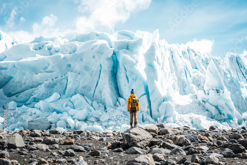 Fotografie, Obraz Backpacker doing a trekking on the Perito Moreno Glacier