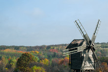 Old Wooden Windmill On A Hill....