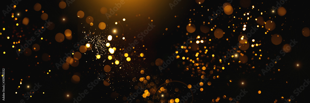 Fototapeta Golden abstract bokeh on black background. Holiday concept