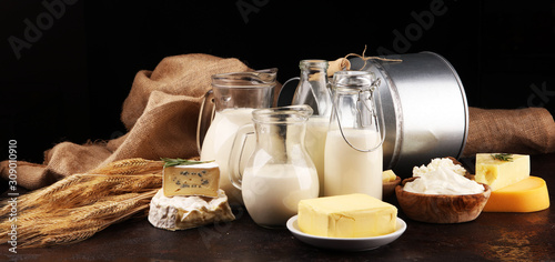 Fotomural Different  healthy dairy products on rustic background with milk, cheese, butter