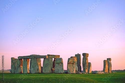 Fotografia Stonehenge at pastel colourful sunset sky
