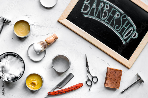 Fototapeta  babrer workplace with tools on white background top view