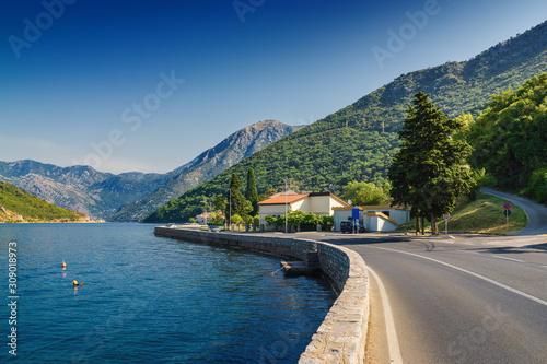 Sunny morning view of Kotor bay and coastal road near Tivat, Montenegro Wallpaper Mural