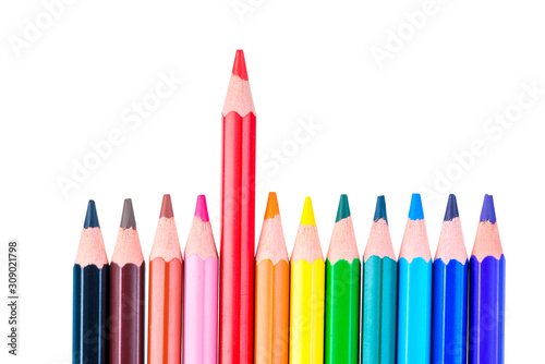 Obraz concept photo of a red pencil stand out from a row of colored pencils on a white background isolated - fototapety do salonu