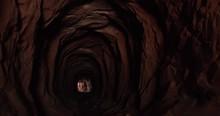 Walking Through A Cave With Li...