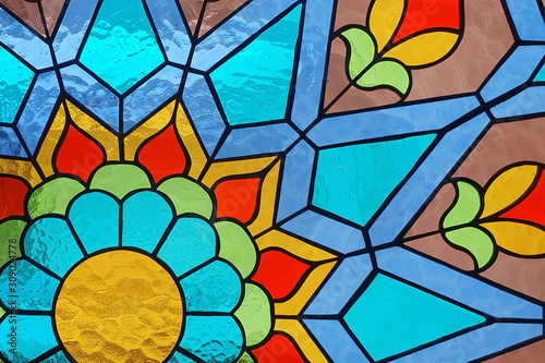 Photo Stained glass floral geometric pattern.