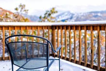 Wooden Railing Of Deck Balcony Terrace And Metal Chair In Garden Outside In Aspen, Colorado View Of Rocky Mountains And Snow Covered Weather