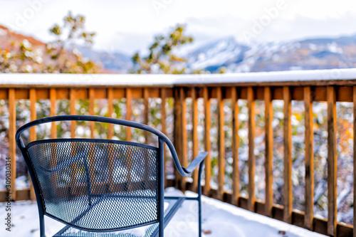 Carta da parati Wooden railing of deck balcony terrace and metal chair in garden outside in Aspe