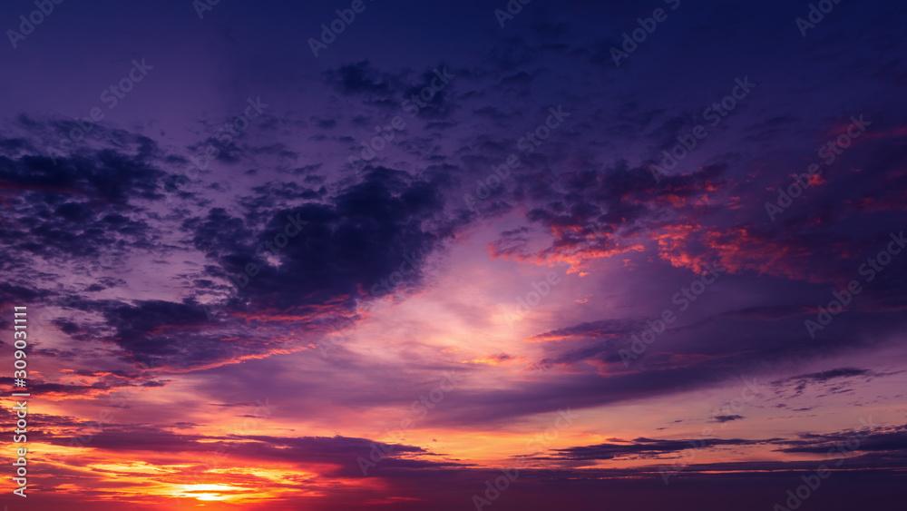 Fototapeta Dramatic cloudscape at sunrise over ocean