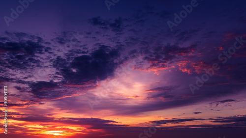 Obraz Dramatic cloudscape at sunrise over ocean - fototapety do salonu