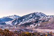 Aspen, Colorado Rocky Mountains High Angle View Of Snow Covered Highlands And Small Airport Runway In Roaring Fork Valley In Autumn