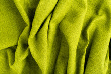 Wave Green Natural Linen Fabric Textile Material Texture As A Background. Green Textile Pattern For Design In Fashion As Abstract Background. Abstract Green Natural Fabric Background.