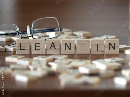 lean in the word or concept represented by wooden letter tiles Wallpaper Mural