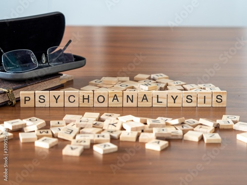 Fototapeta psychoanalysis the word or concept represented by wooden letter tiles