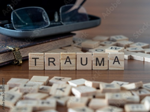 Photo trauma the word or concept represented by wooden letter tiles