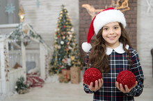 Trendy Kid Decorative Xmas Ball. Happiness And Cheer. Moring Before Xmas. Happy New Year. Smiling Child In Santa Hat. Winter Holiday Activity. Christmas Shopping. Small Girl Elf Costume