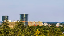 View On The City Buildings From The Forest Of Apeldoorn, Popular Dutch City, The Netherlands