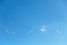 Small Clouds And Airplane Whit...