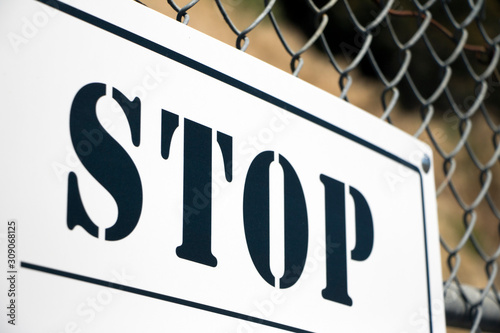 'STOP' sign affixed to chain link fence Canvas Print