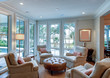 Beautiful sitting room interior with view out onto waterfront property.