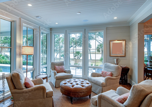 Beautiful sitting room interior with view out onto waterfront property Fototapet