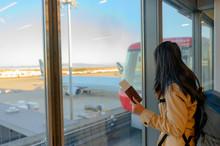 Passenger Tourist Holding Pass...